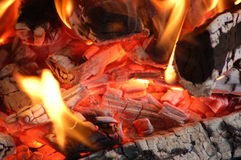 Flaming Embers. Burning embers from a fireplace Royalty Free Stock Photography