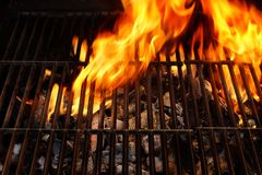 Flaming Empty BBQ Grill. Flaming BBQ Grill close-up. Background  with space for text or image Stock Photography