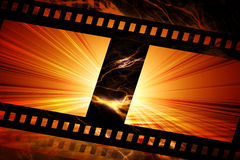 Flaming film strip. With red background Royalty Free Stock Images