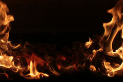 Flaming fire on black Royalty Free Stock Photos