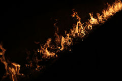 Flaming fire on black Stock Photos
