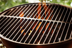 Flaming fire in a portable summer barbecue royalty free stock images