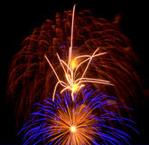Flaming Fireworks with Blue Secondary Explosion Stock Image