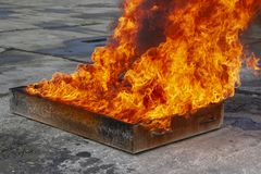 Flame in an iron box with water. royalty free stock photo