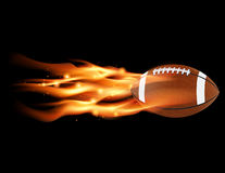 Flaming Football. A flaming football flying against a black background. Vector EPS 10 available. EPS file contains transparencies and gradient mesh royalty free illustration