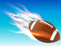 Flaming Football. A flaming football flying in the blue sky. Vector EPS 10 available. EPS file contains transparencies and gradient mesh stock illustration