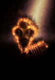 Flaming Gas Mask on Dark Background. Old Fashioned Gas Mask, Used to Protect Against Inhalation of Dangerous Chemical Fumes and in War, on Fire and Dramatically Stock Images