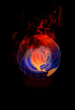 Flaming Globe on Black. Glowing globe with red flames on a black background with @ at symbol Royalty Free Stock Photo