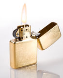 Flaming golden lighter Stock Image