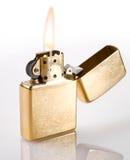 Flaming Golden Lighter Stock Image