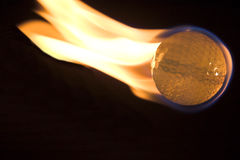 Flaming Golf Ball Stock Photography