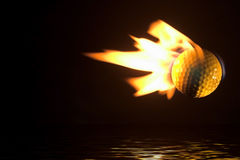Flaming Golf Ball Over Water. A flaming golf ball flying over a water hazard royalty free stock images
