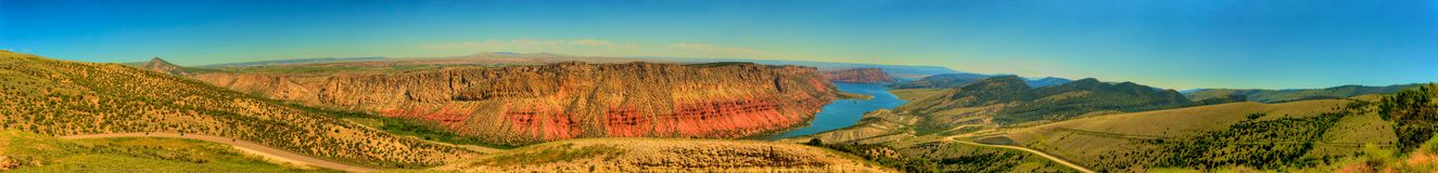 Flaming Gorge Panorama. In South West Wyoming there is a rock formation carved out by the waters of the Green River that looks as if it were painted in rich hues Stock Images