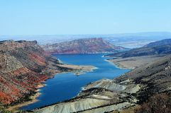 Flaming Gorge Deep Blue Reservoir, Utah. Flaming Gorge Reservoir touching Utah and Wyoming surrounded by colorful sandstone and quartzite hills stock photo