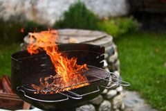 Flaming grill Royalty Free Stock Images