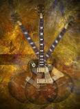 Flaming guitar. Electric guitar on flaming background Stock Photo