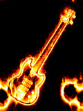 Flaming guitar. Electronic guitar in flames on a black background Stock Photography