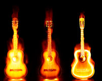 Flaming guitar on fire. Three  images of an acoustic guitar on fire Royalty Free Stock Photography