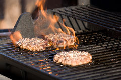 Flaming Hamburgers Royalty Free Stock Image