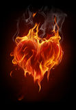 Flaming heart. Fire heart on black background Royalty Free Stock Photos