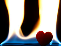 Flaming heart on a black background. Royalty Free Stock Photography