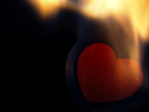 Flaming heart on a black background. Royalty Free Stock Images
