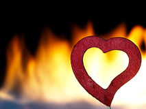 Flaming heart on a black background. Stock Photos