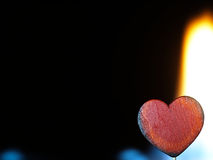 Flaming heart on a black background. Fire burning heart. Pulsating orange flames on a black background Royalty Free Stock Image