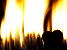 Flaming heart on a black background. Stock Photography