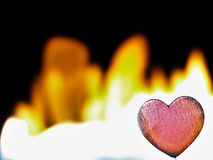 Flaming heart on a black background. Stock Image