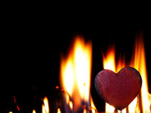 Flaming heart on a black background. Fire burning heart. Pulsating orange flames on a black background Royalty Free Stock Photos