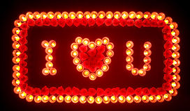 Flaming heart of candles Royalty Free Stock Images