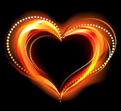 Flaming heart. The heart of the red fire on a black background Royalty Free Stock Photos