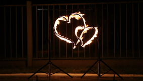 Flaming heart. Two hearts glowing wire on nature stock video footage