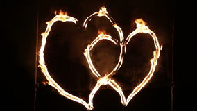 Flaming heart. Two hearts glowing wire out stock footage