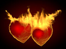 Flaming hearts. Two flaming hearts on fire, on a dark background Stock Images