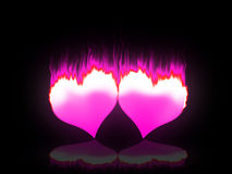 Flaming hearts. Two red hearts burning for love and passion Royalty Free Stock Photos