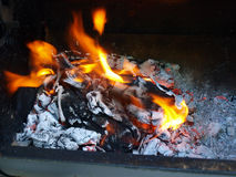 Flaming hot coals Royalty Free Stock Photos