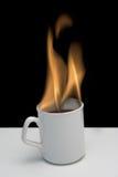 Flaming Hot Coffee. Flaming coffee in white mug stock photo