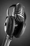 Flaming Hot Event. Black & White 50's microphone with headphones & clipping path included for those who need a different background Royalty Free Stock Images