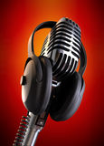 Flaming Hot Event. 50's microphone with headphones with a red background & clipping path included for those who need a different background Royalty Free Stock Photo