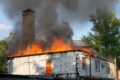 Flaming house Stock Image