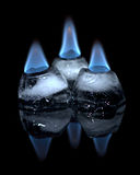 Flaming Ice. On a very inspired night.  I photographed three ice cubes.  These ice cubes were lit by sanitizer gel.  Single image was generated by setting the Royalty Free Stock Photos