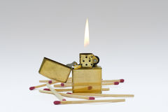 Flaming lighter. And matches(isolated Royalty Free Stock Photo