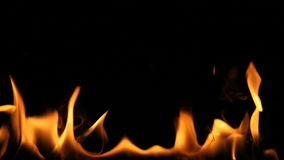 Flaming Log. With black background stock video footage