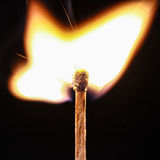 Flaming matchstick Royalty Free Stock Images