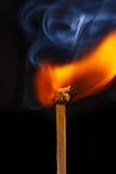 Flaming matchstick Stock Image