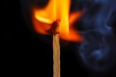 Flaming matchstick. Macro shot of a flaming matchstick stock photo
