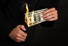 Flaming money Stock Photo