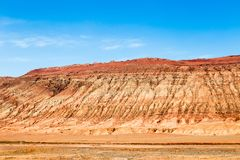 "Flaming mountains, Turpan, Xinjiang, China: these intense red mountains appear in the Chinese epic ""Journey to the west"". Flaming mountains, Turpan stock photos"
